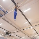 Athlete trampoline courses. Athlete gymnast on trampoline Chasing Dreams in a trampoline club