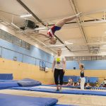 Athlete trampoline courses. Athlete gymnast on trampoline Chasing Dreams in a trampoline club. Kingston Trampoline Academy. One of the leading trampoline clubs in the UK.