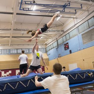 Athlete gymnast on trampoline Chasing Dreams in a trampoline club. Kingston Trampoline Academy. One of the leading trampoline clubs in the UK.
