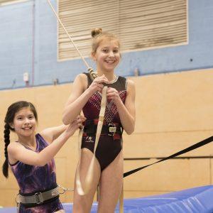 girls organising trampoline safety equipment. Trampoline courses for all. trampoline club.