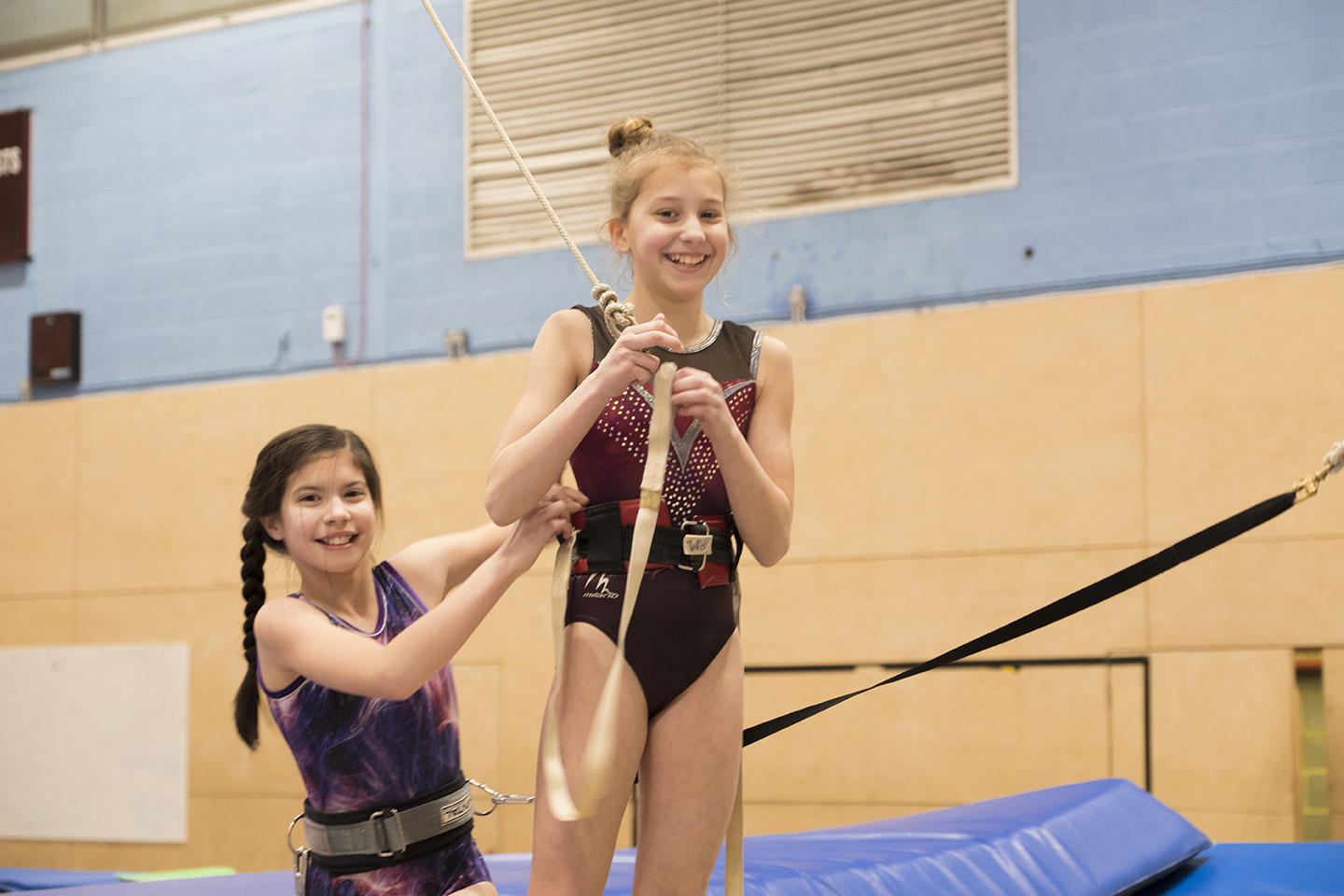 girls organising trampoline safety equipment. Trampoline courses for all. trampoline club.