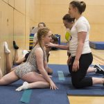 Athlete gymnast stretching. Athlete trampoline courses at Kingston Trampoline Academy