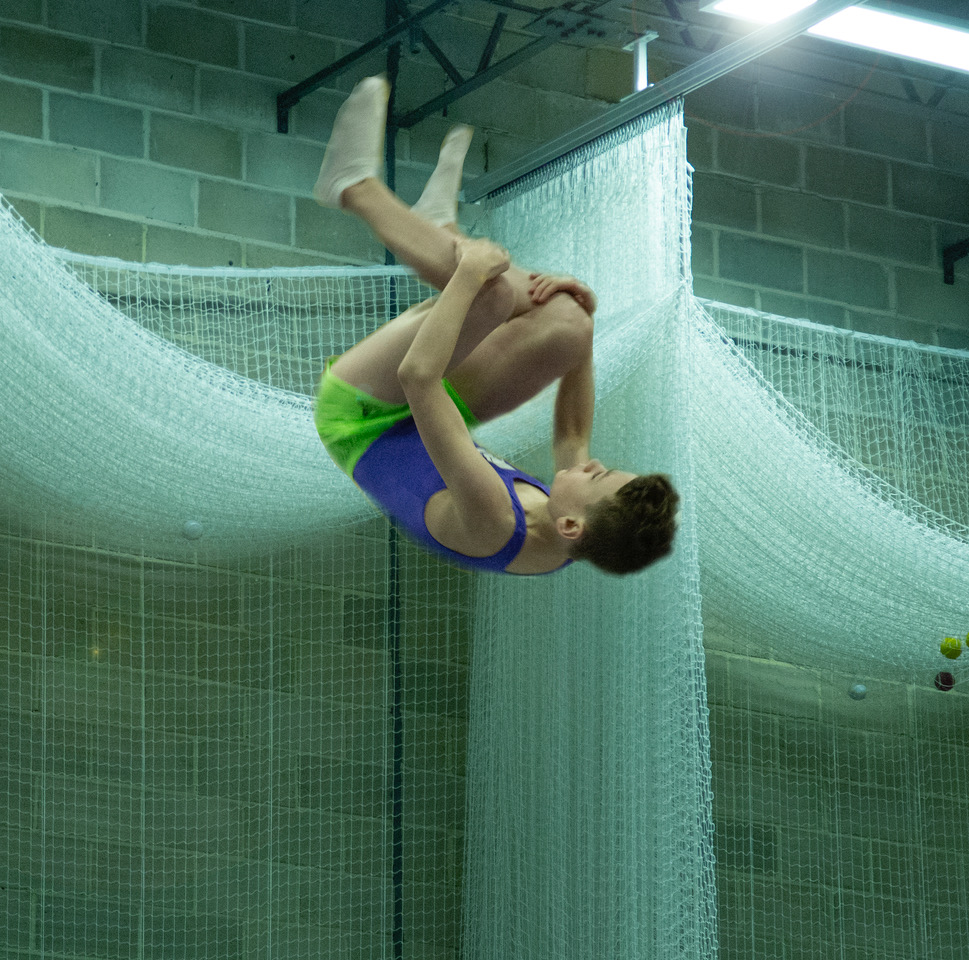 Young trampoline gymnast in action on a trampoline